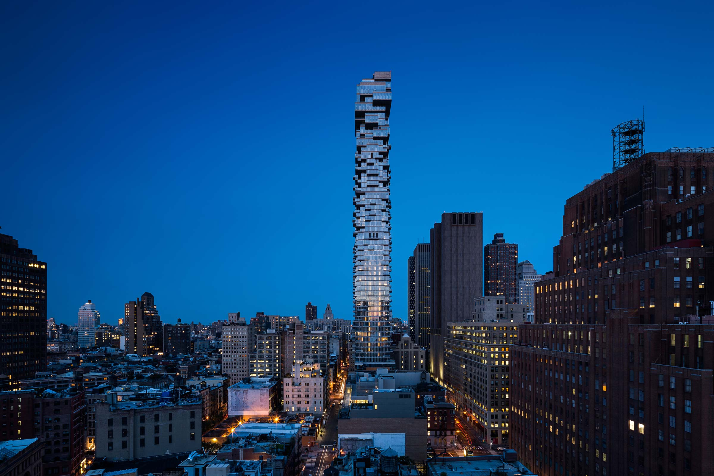 56 Leonard is a vertical glass expression of sculpted surfaces, cantilevers, and sparkling glass